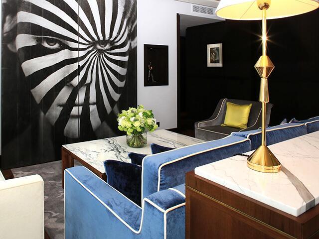 blue velvet couch in lounge