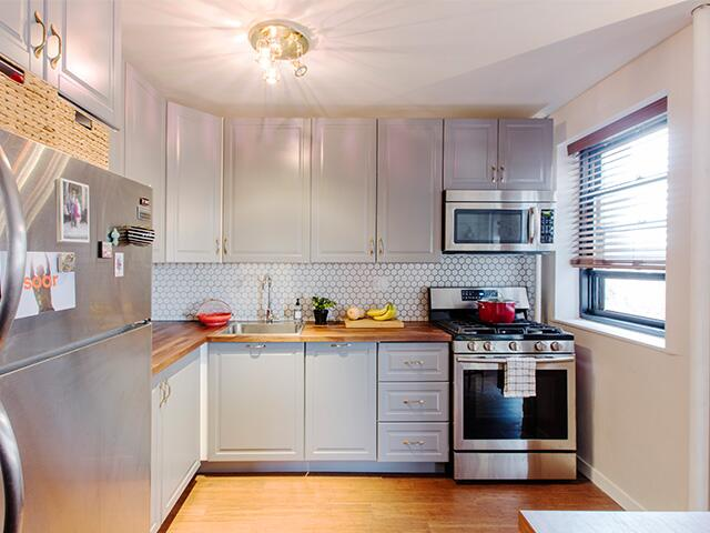 Laura and Matthew worked with a Sweeten expert to make a plan: rebuild kitchen cabinets, replace all the finishes and redo the tired parquet flooring.