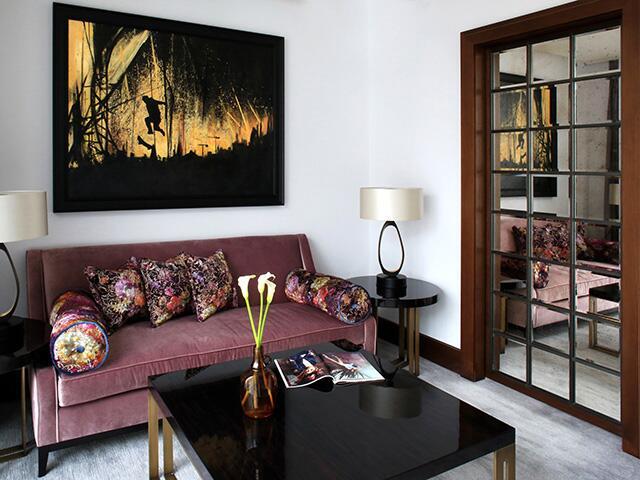 velvet couch in bedroom