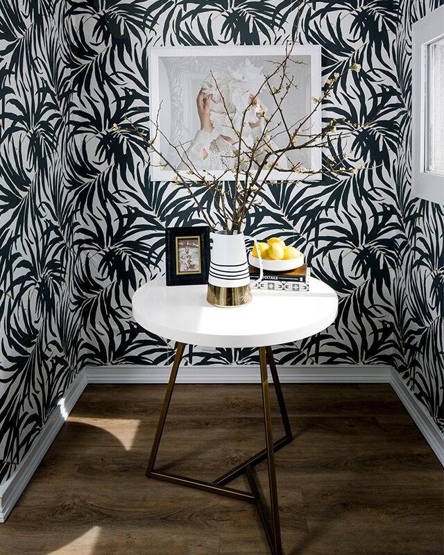 You need to see Havenly Head of Design Shelby Girard's black and white chic, modern home makeover—we love the all white kitchen, black canopy bed, open floor plan, plush seating and palm print wallpaper! Click to see more of this gorgeous space.