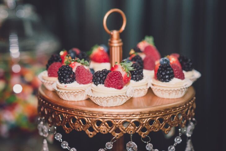 A rose gold stand with dangling crystals displayed gluten-free tarts, topped with fresh strawberries and blackberries for guests to snack on. In addition to sweets, an abundant amount of other desserts satisfied each sweet tooth at the reception.