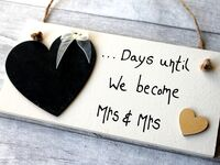 Chalkboard heart with '...Days until we become Mrs & Mrs' on white wooden sign