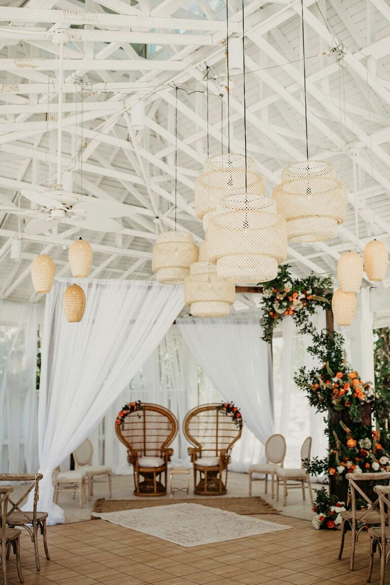 Boho ceremony space with woven chandeliers
