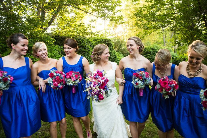 The bridesmaid dresses and shoes set the tone for their vibrant color palette—bright cobalt dresses by LuluKaternand raspberry Michael Kors sandals.