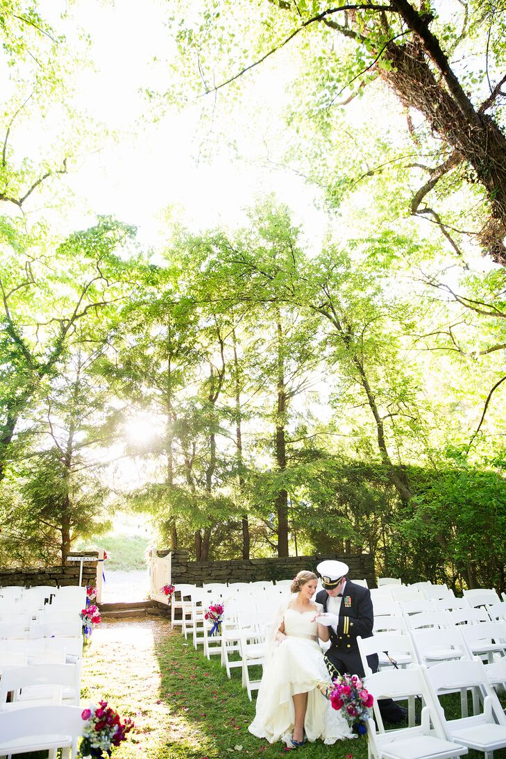 """Old trees flanked the outdoors ceremony. """"We had quite a big wedding so my cousin built a stage outside of the walled tennis court for the wedding party,"""" says Liz."""