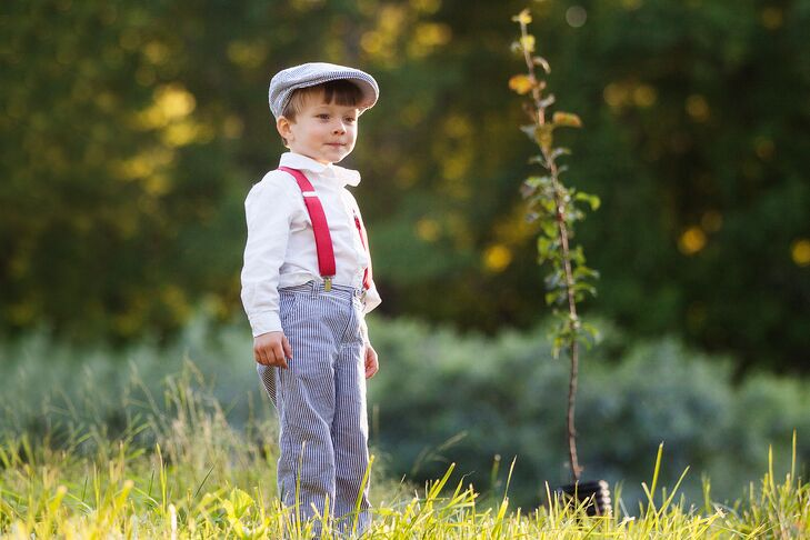 Adorable Ring Bearer with Red Suspenders and a Matching Newsboy Cap