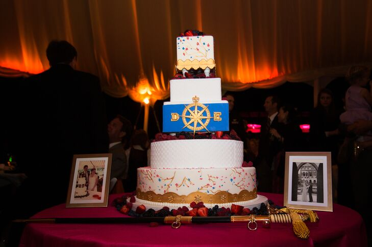 In keeping with the fresh fruit theme, the five-tiered wedding cake was topped with fresh berries. A gold scalloped base and white fondant pearls. The couple's monogram decorated the middle cobalt blue layer and a gold scalloped base contrasted with a white basket weave pattern.rn