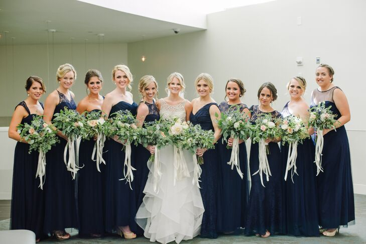 The only criteria Millie had for her bridesmaid dresses was that they be navy and floor length. It was important to her that all her best friends felt comfortable, so in order to accommodate a range of body types, she let each woman choose a gown in a different style.