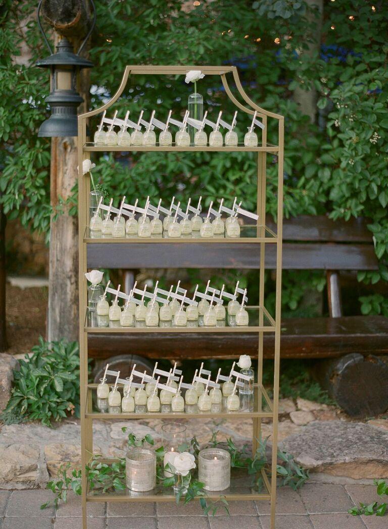 Mini bottles of tequila as escort cards on metal shelf