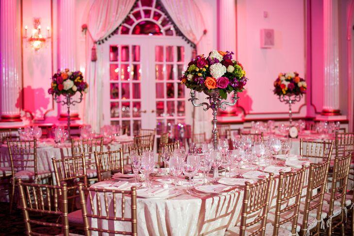 Elegant Gold Chiavari Chairs Under Pink Uplighting