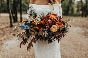 Orange Roses and Hypericum Berries in Cascading Bouquet