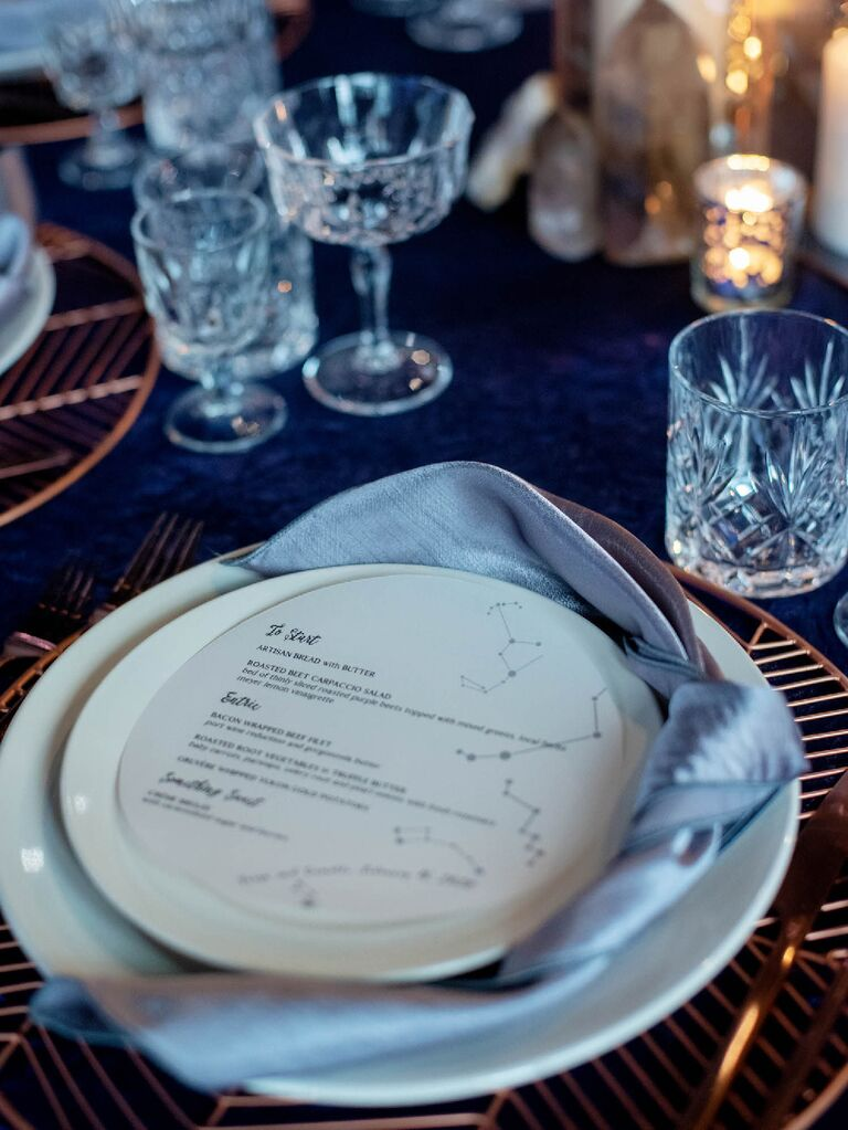 Constellation-printed menu at celestial wedding reception