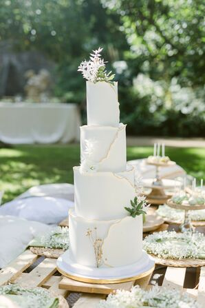Four-Tier Cake With Gold Accents and Leaves