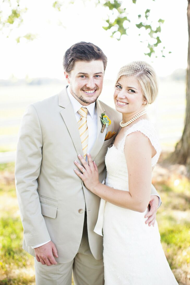 Krysten went with a classic ivory lace gown, while Lucas chose a khaki suit.