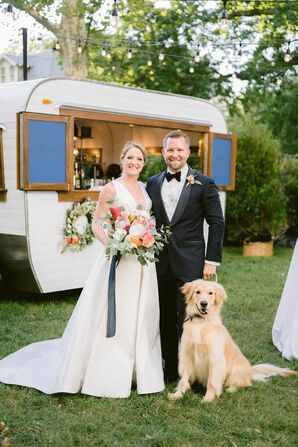 Couple Posing With Dog in Front of Mobile Bar