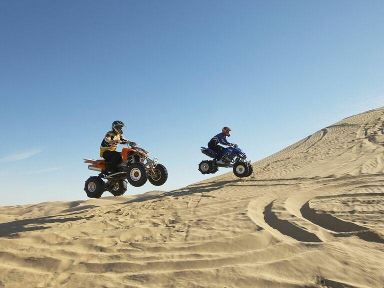 Guys on ATVs in the desert