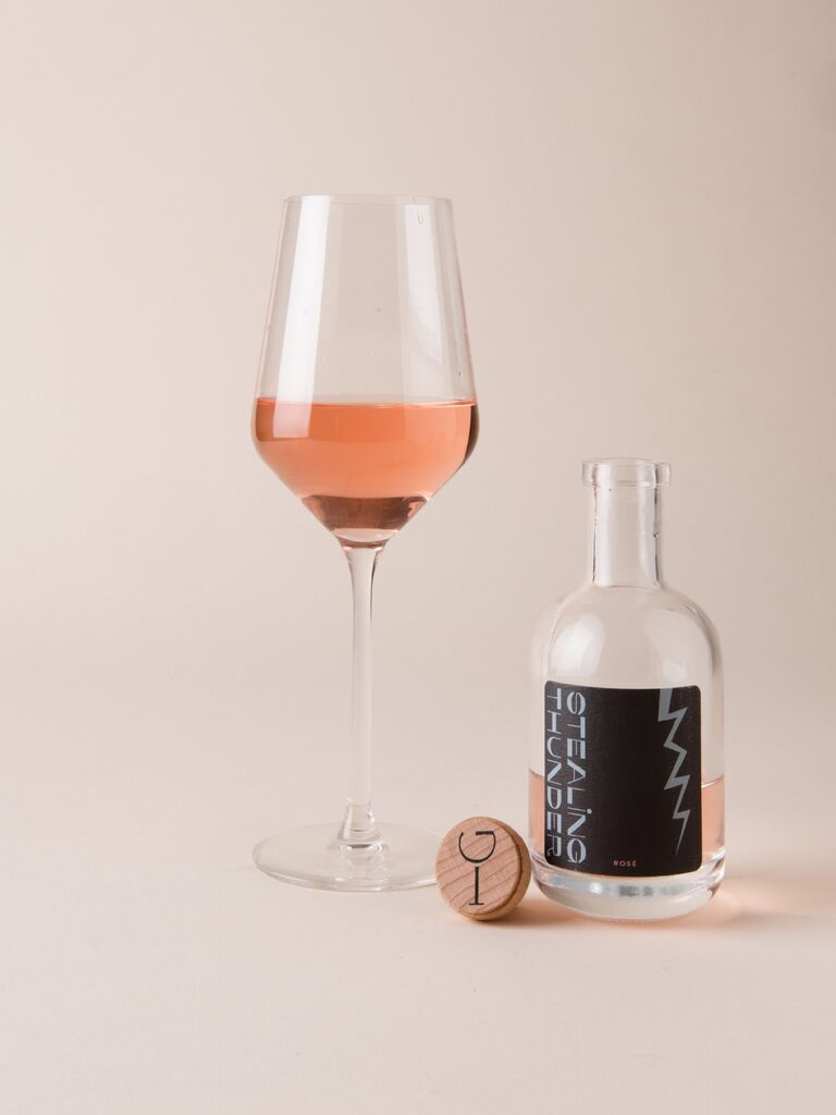 Glass of rosé next to empty bottle