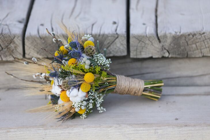 Sarah's rustic bouquet was a mix of blue thistle, yellow billy balls, scabiosa pods, cotton and Baby's Breath.