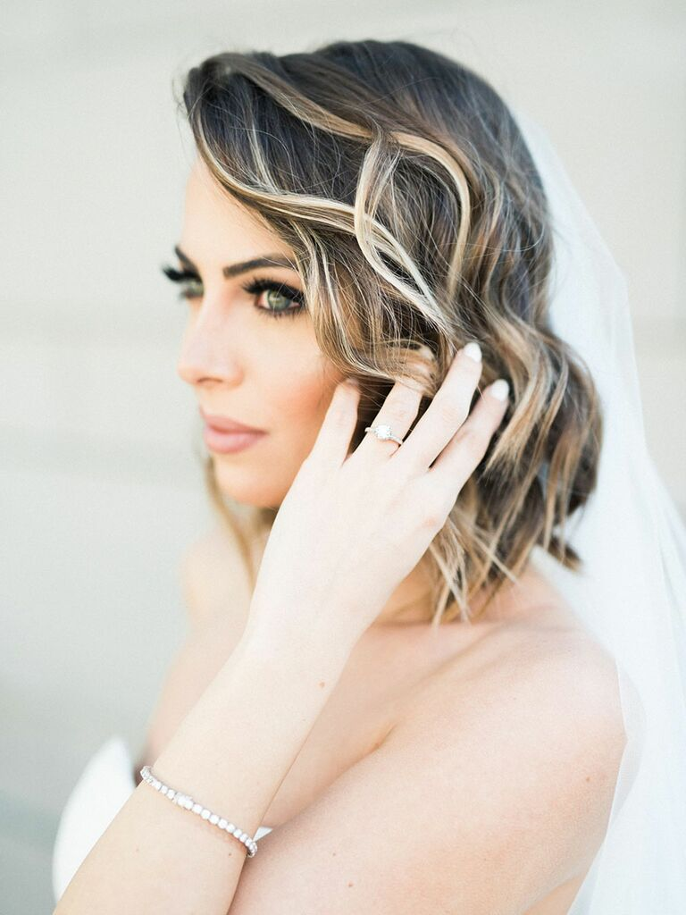 Bride chooses a piecey, styled bob for her wedding day.
