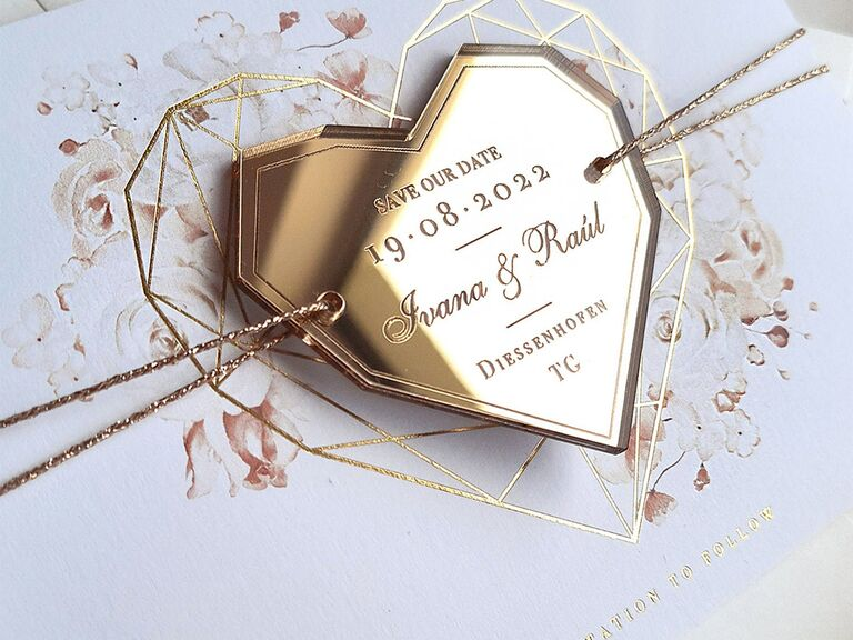 Gold metallic heart magnet with event details engraved