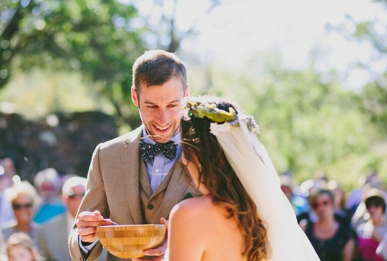 groom eating from bowl of cornmeal at Native American Wedding