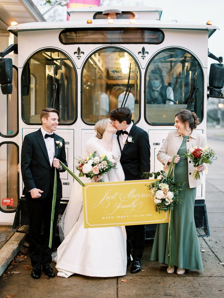 Couple Shares Kiss in Front of Trolley at Missouri Wedding