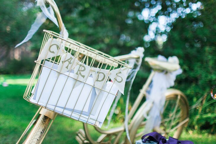 Cards from guests were collected in the basket on a vintage gold bicycle.