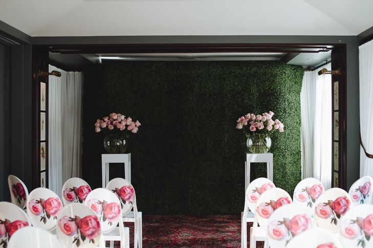 The festivities kicked off with an indoor ceremony on the rooftop of the NoMad Hotel in New York, New York. A grassy backdrop, bouquets of fresh blush roses and modern white chairs decorated with pink rose decals channeled an English garden at the peak of summer, bringing Whitney and Ryan's whimsical vision to life.