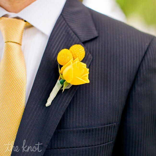 Phil wore a yellow rose and billy ball boutonniere to match his gold tie.