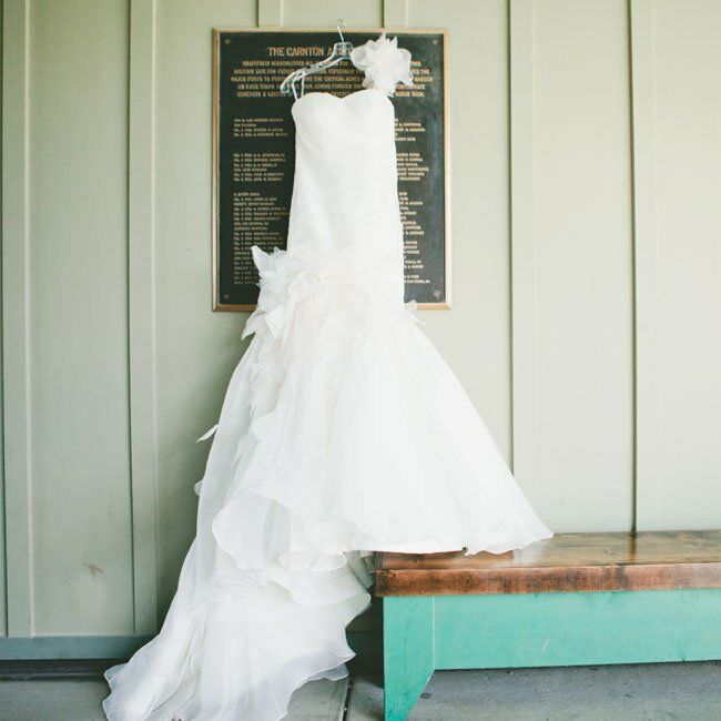 Megan wore a stunning dress by Martina Liana. Flowing organza detailing gave the one-shouldered mermaid-style gown a whimsical flair.