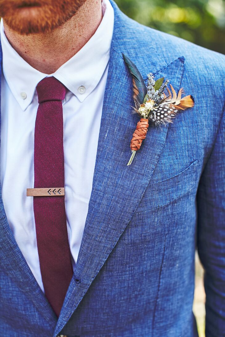 Angela made Cameron's boutonniere with lavender, globe thistle and feathers, then wrapped it in brown leather.
