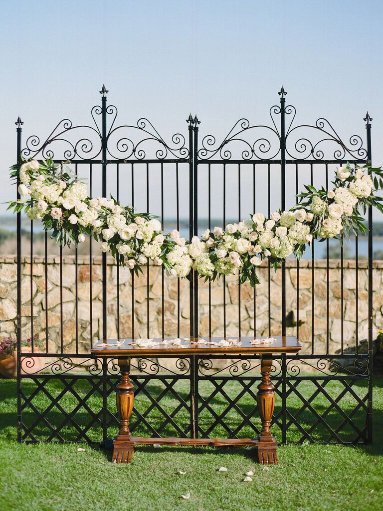 wrought-iron gates ceremony backdrop for outdoor wedding