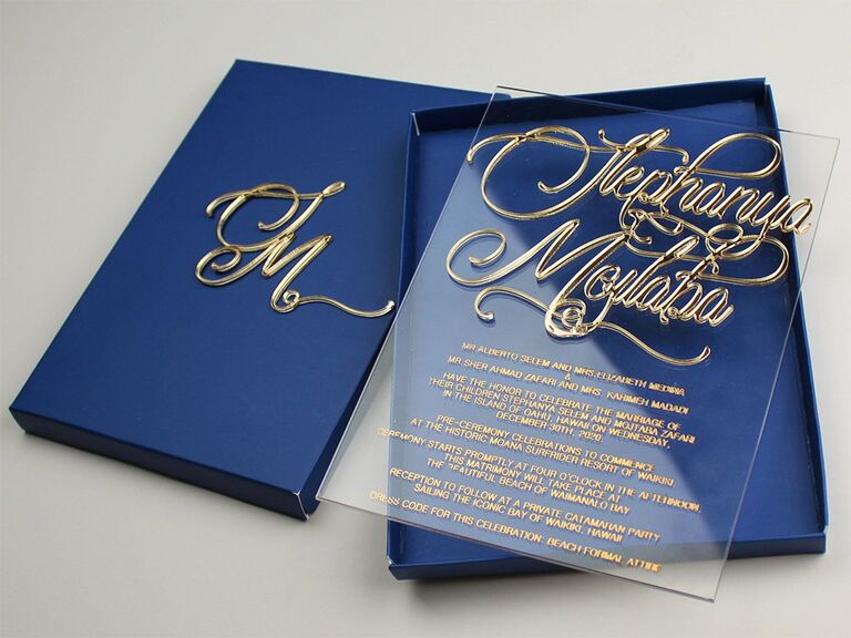 Blue box with event details on clear acrylic in gold calligraphy