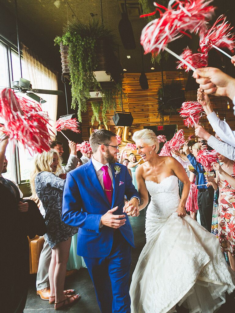 Wedding exit with red and white cheer pom-poms