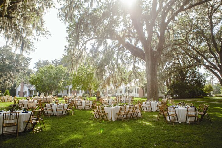 """""""After setting eyes on the historic home surrounded by large live oaks and Spanish moss, it was hard to imagine the wedding anywhere else,"""" Meghan says of their venue. """"SouthWood House & Cottages was the perfect combination of natural beauty and Southern charm."""""""