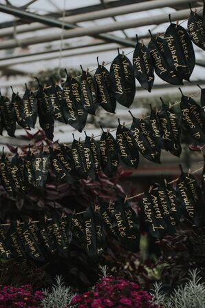 Black Leaf Escort Cards with Gold Calligraphy