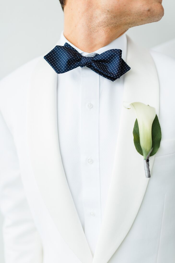 """""""We wanted all florals to be simple, sleek and somewhat masculine,"""" Wes says. """"All flower arrangements and the grooms' boutonnieres were white calla lilies."""""""