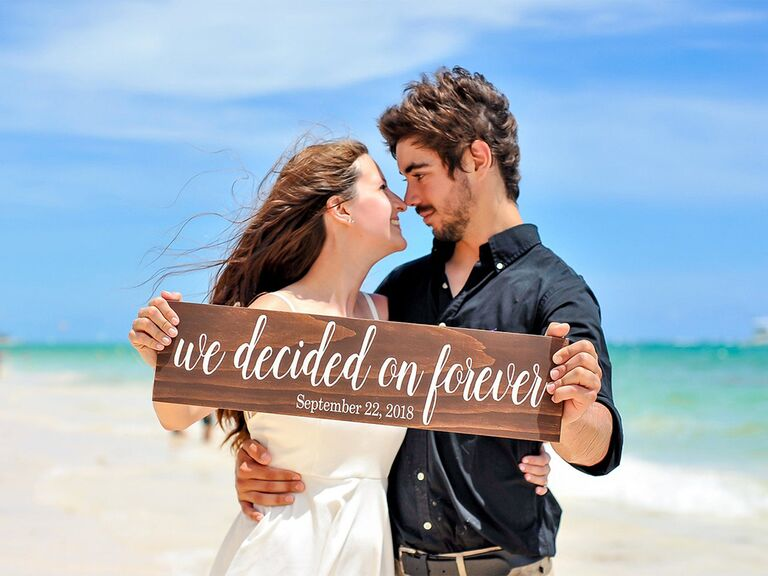 'we decided on forever' and date in white script on wooden sign