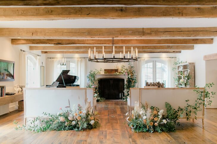 Ceremony Venue with Upholstered Furniture and Exposed Wood Beams