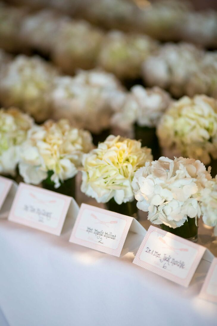 The oars decorating the blush escort cards were an homage to the boathouse venue.