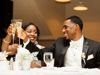 Couple wedding toast during wedding reception.