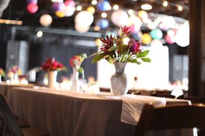 Purple and Red Centerpieces in Milk Glass Vases