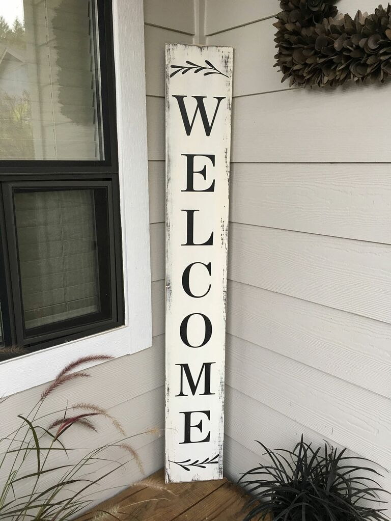 Tall wooden wedding welcome sign