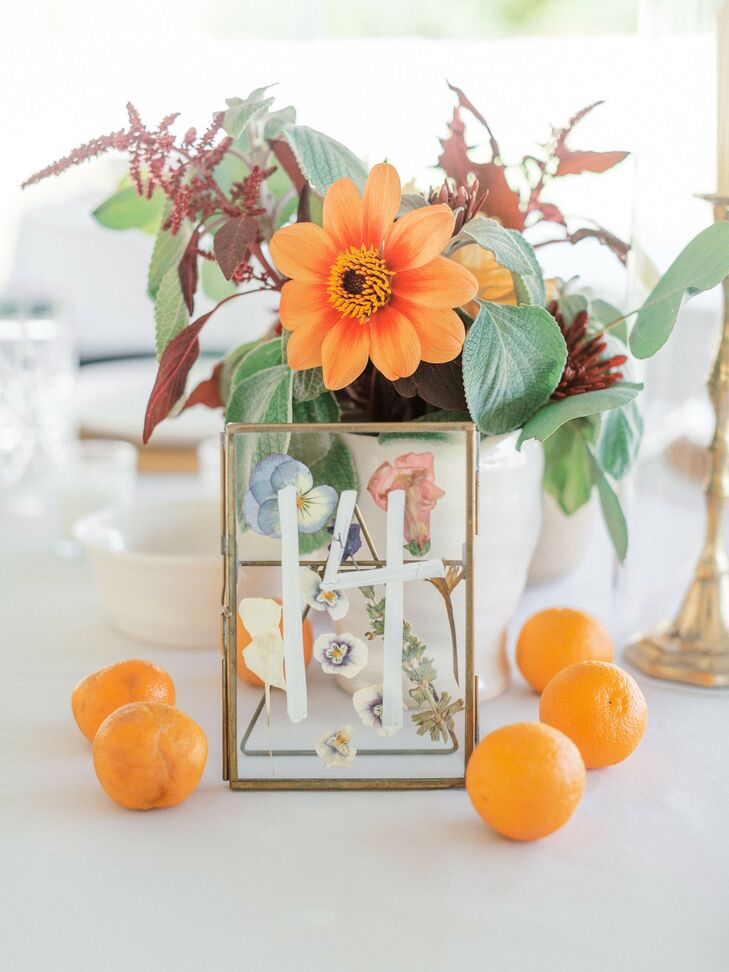 Table Number with Pressed Flowers and Fresh Oranges