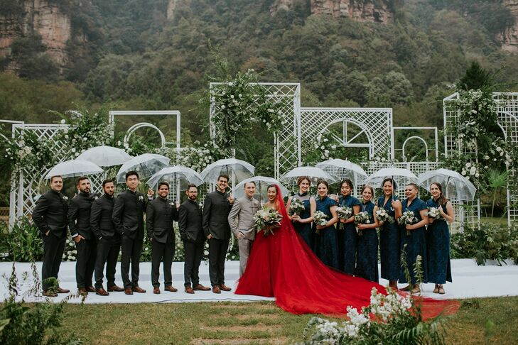 Wedding Party Portraits With Umbrellas in the Rain