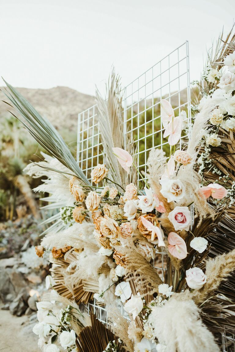 neutral wedding flower arrangement with 2021 wedding colors pampas grass white flowers pale pink roses