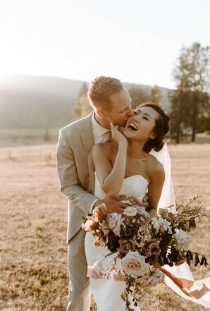 Couple Laughing and Kissing at Tin Roof Barn in White Salmon, Washington