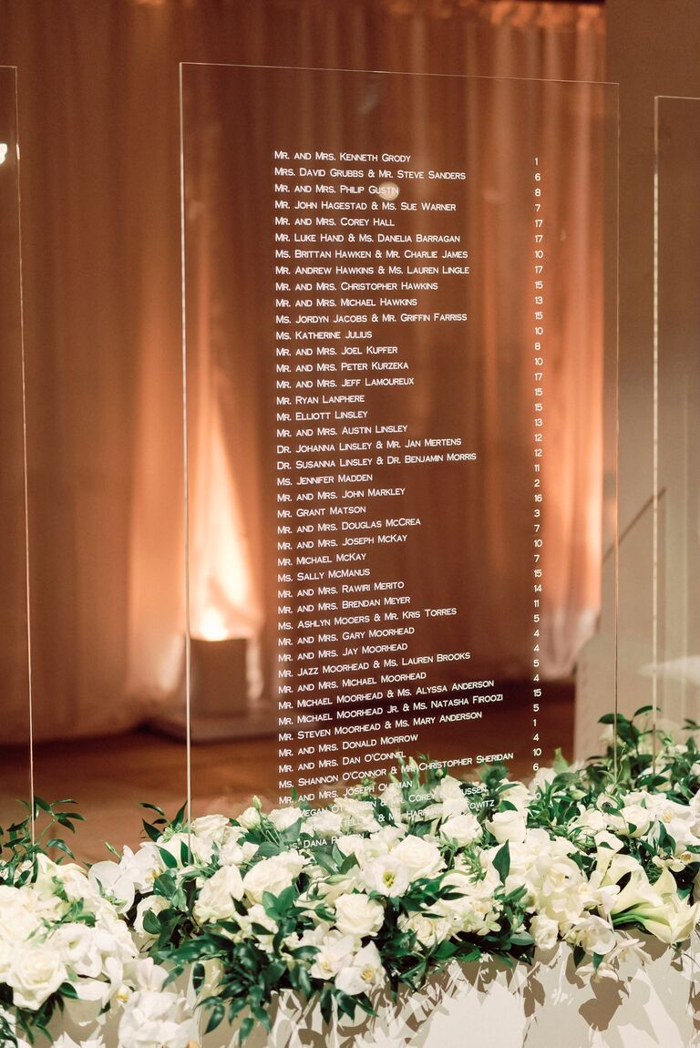 Modern acrylic seating chart with white flower accents
