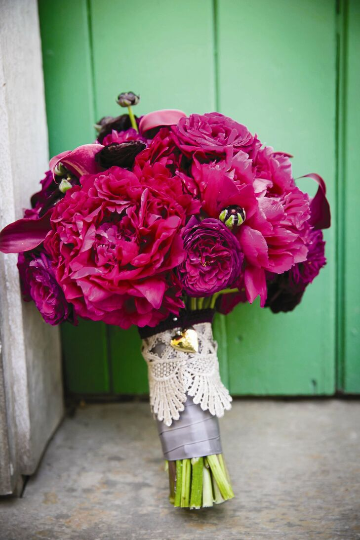 Peonies, ranunculuses and roses in plum and fig hues made up the bride's bouquet.