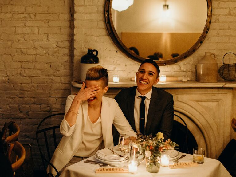 Couple laughing during wedding speeches.